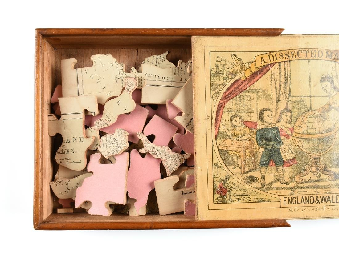 """A BOXED PEACOCK & CO. TOY JIGSAW PUZZLE, """"A DISSECTED - 7"""