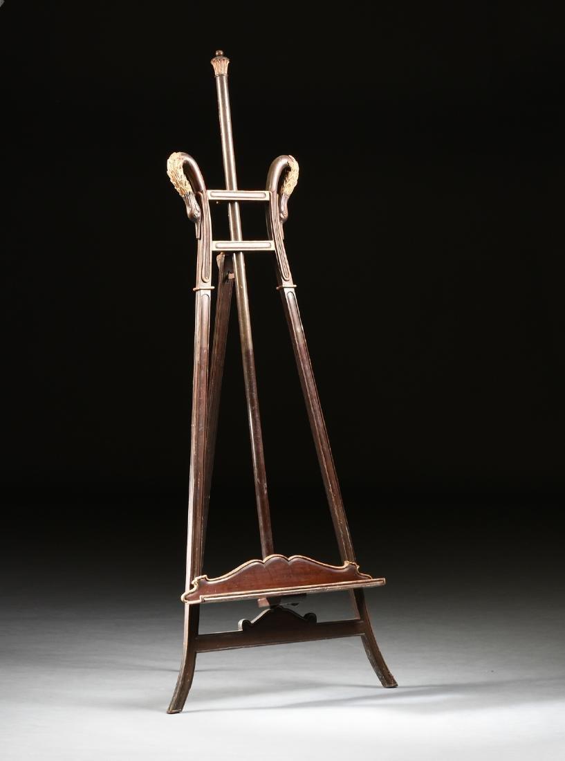 AN ART NOUVEAU PARCEL GILT MAHOGANY EASEL, 1890-1910,