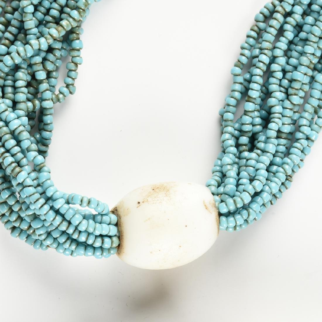 A WEST AFRICAN MILK GLASS, SEED BEAD AND COWRIE SHELL - 4