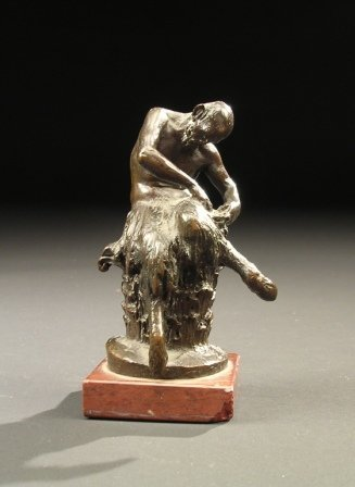 4: A LATE 19TH CENTURY PATINATED BRONZE FIGURE of a sat