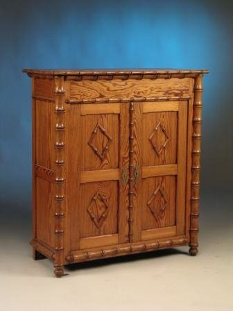 15: A VICTORIAN PINE FAUX BAMBOO CABINET, the rectangul