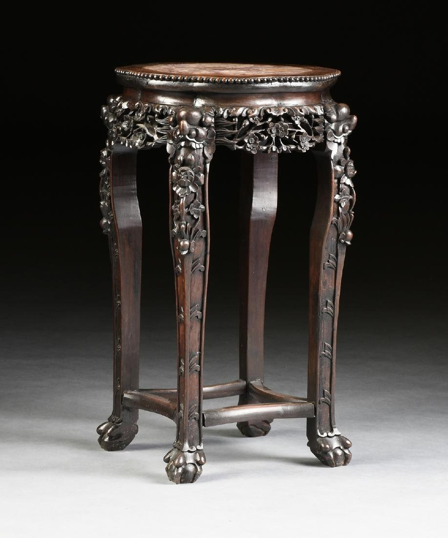 A CHINESE MARBLE TOPPED AND CARVED HARDWOOD STAND,