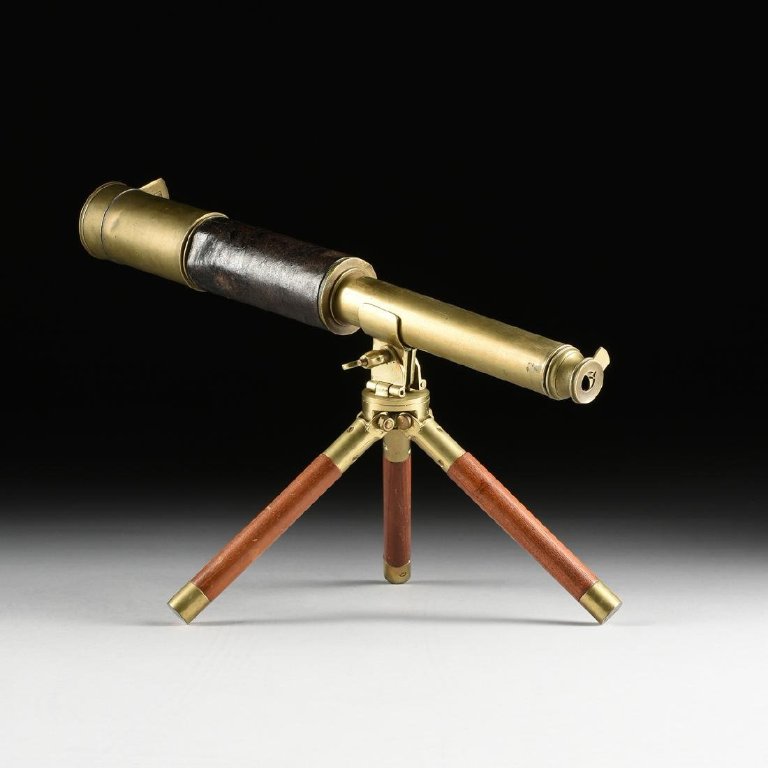 AN ANGLO/AMERICAN LEATHER WRAPPED BRASS TELESCOPE AND