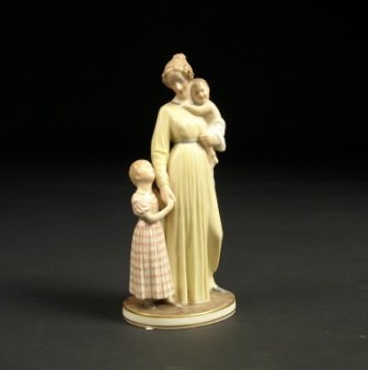 12: A ROYAL COPENHAGEN FIGURAL GROUP of a mother and tw