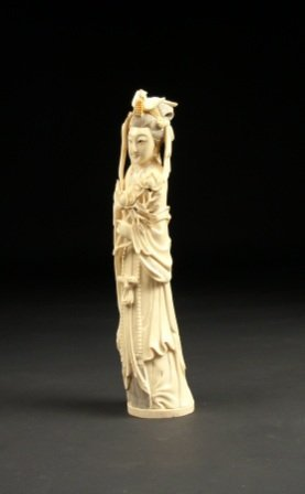 22: A LATE QING DYNASTY CARVED IVORY FIGURE OF QUAN YIN