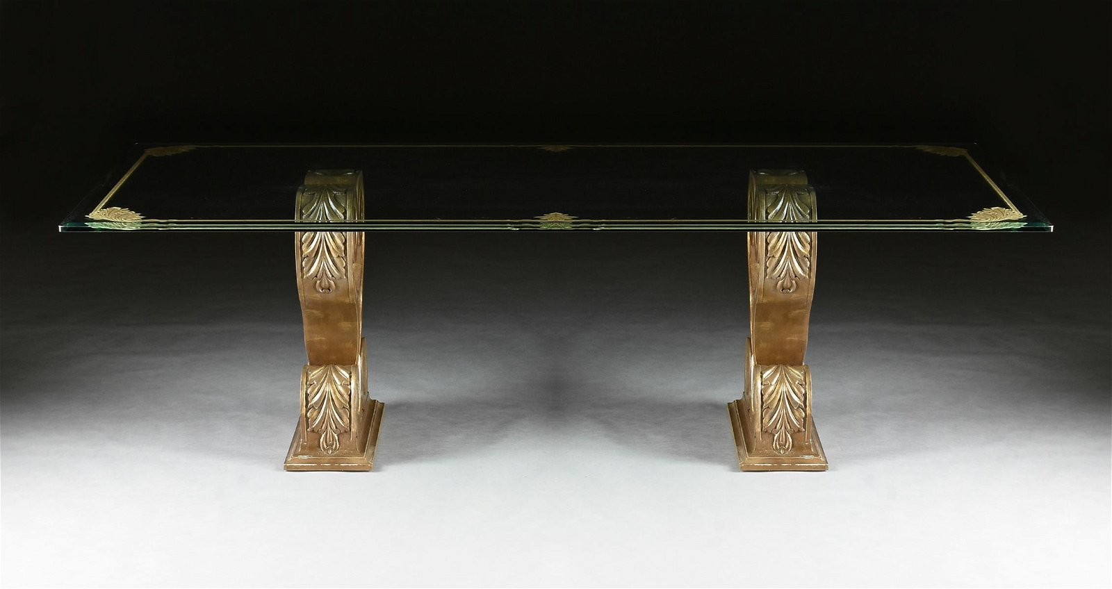 A HOLLYWOOD REGENCY STYLE GILT ETCHED GLASS TOP DUAL