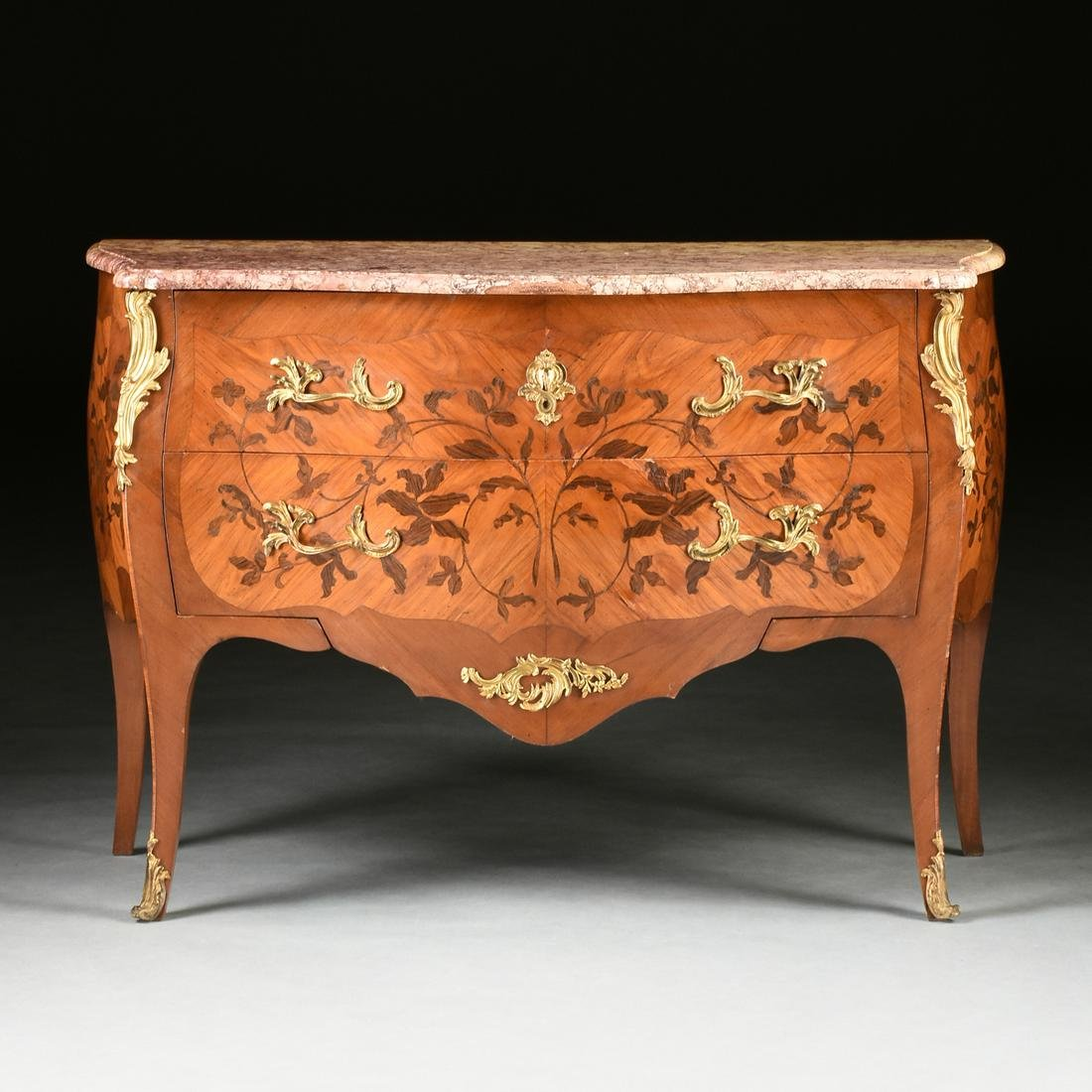 A LOUIS XV STYLE MARBLE TOPPED AND GILT BRONZE MOUNTED