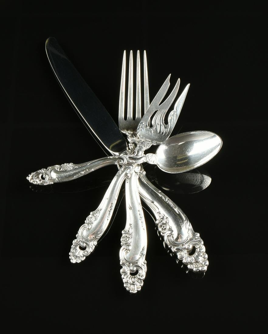 A SIXTY-FOUR PIECE STERLING SILVER FLATWARE SERVICE BY