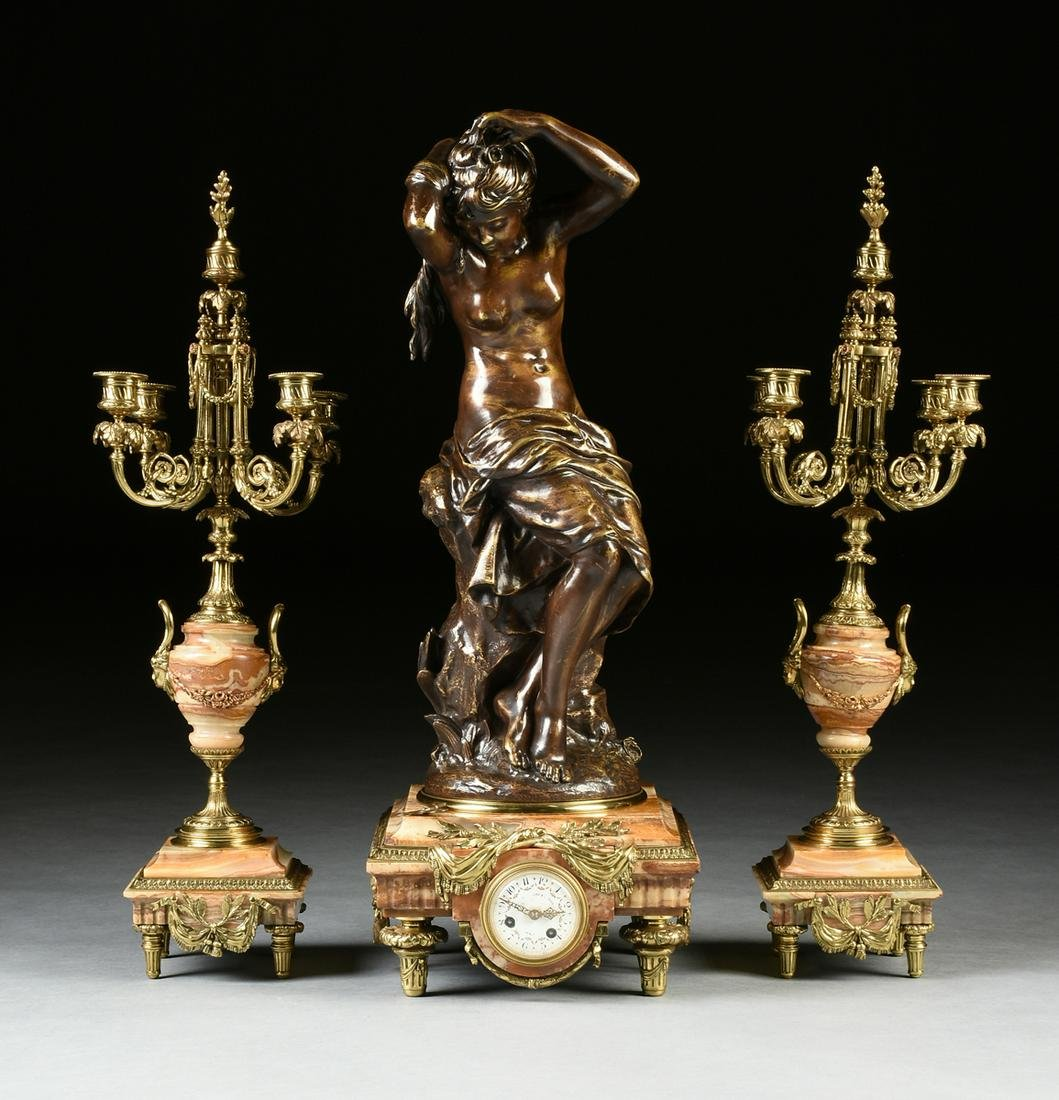 A LOUIS XVI REVIVAL GILT AND PATINATED BRONZE MOUNTED