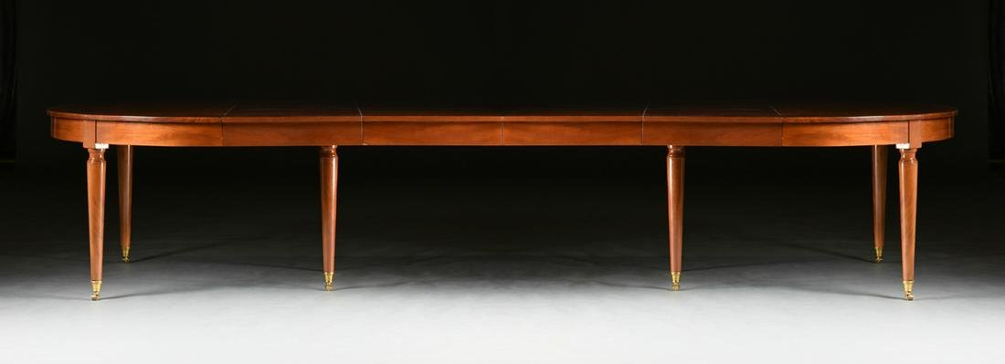 A LOUIS XVI STYLE POLISHED MAHOGANY DINING TABLE,