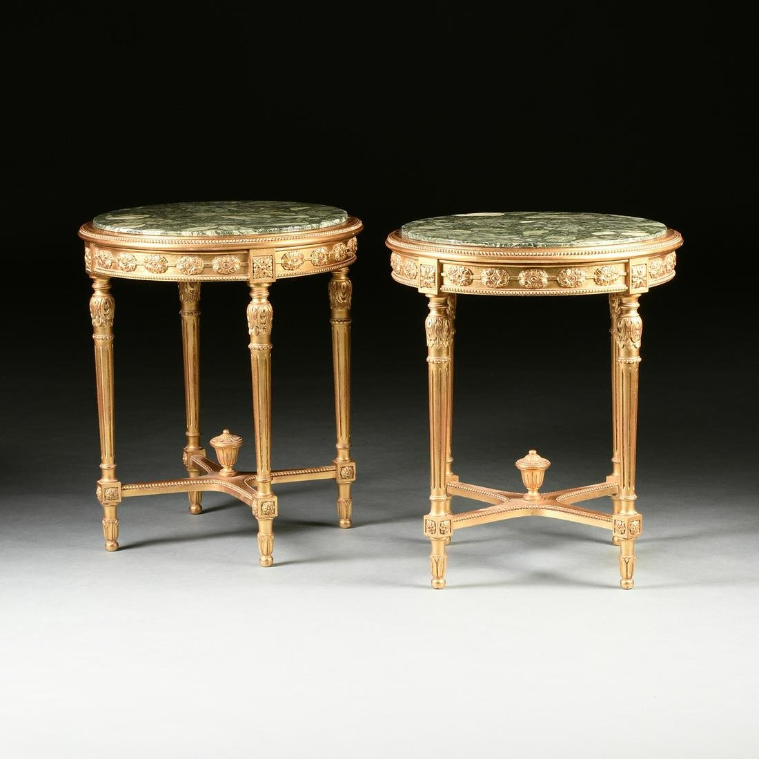 A PAIR OF LOUIS XVI STYLE MARBLE TOPPED AND PARCEL GILT