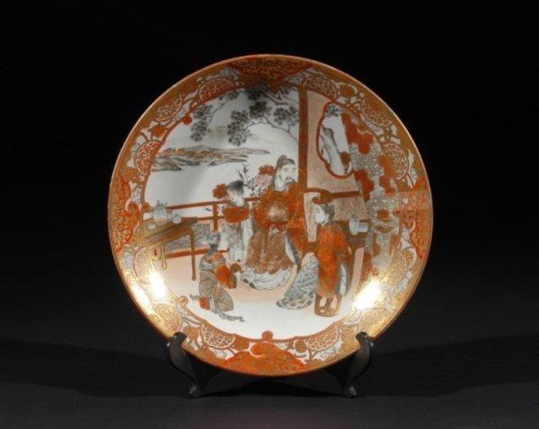 3: A JAPANESE MEIJI PERIOD KUTANI DISH decorated in tra