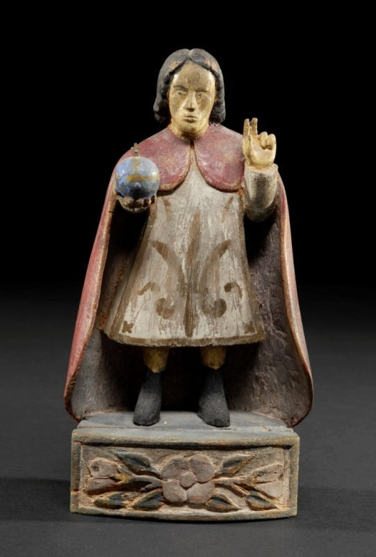 5: A SPANISH COLONIAL PAINTED CARVED WOOD SANTO modeled