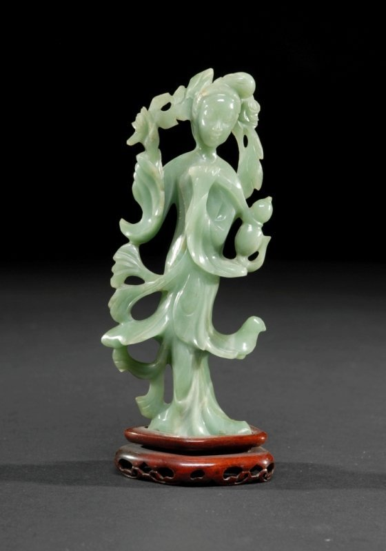 9: A CHINESE CARVED JADE FIGURE OF QUAN YIN, shown in f