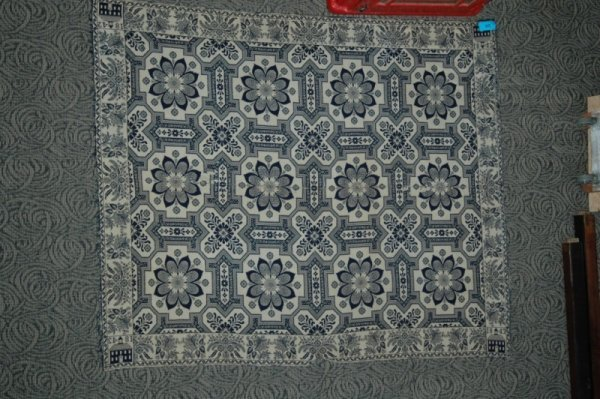 24: AN 1842 AMERICAN JACQUARD WOVEN WOOL COVERLET of re