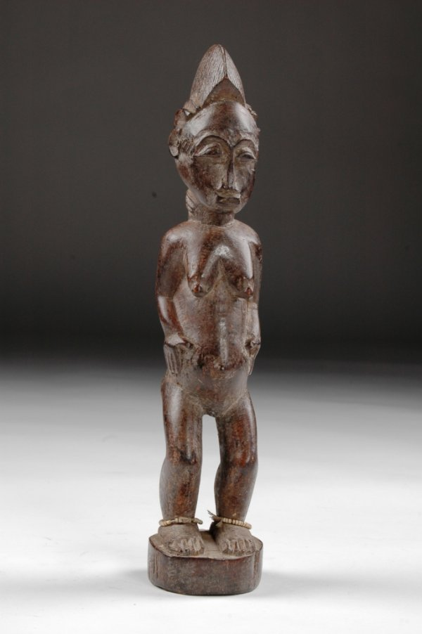 12: A 19TH CENTURY BAULE FEMALE FERTILITY FIGURE,  Ivor