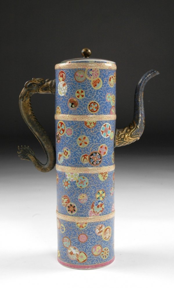 21: A QING DYNASTY GILT BRONZE MOUNTED COVERED PITCHER,