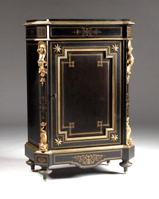 253: A LOUIS XVI STYLE GILT BRONZE MOUNTED AND BRASS IN