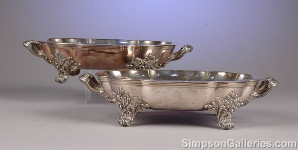 1004: A PAIR OF VICTORIAN SILVER PLATED WARMING STANDS,