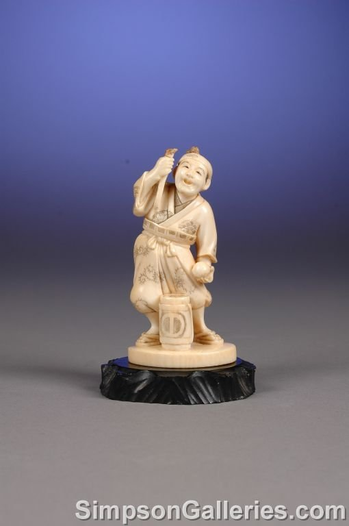 1009: A JAPANESE CARVED IVORY OKIMONO, Meiji Period, th