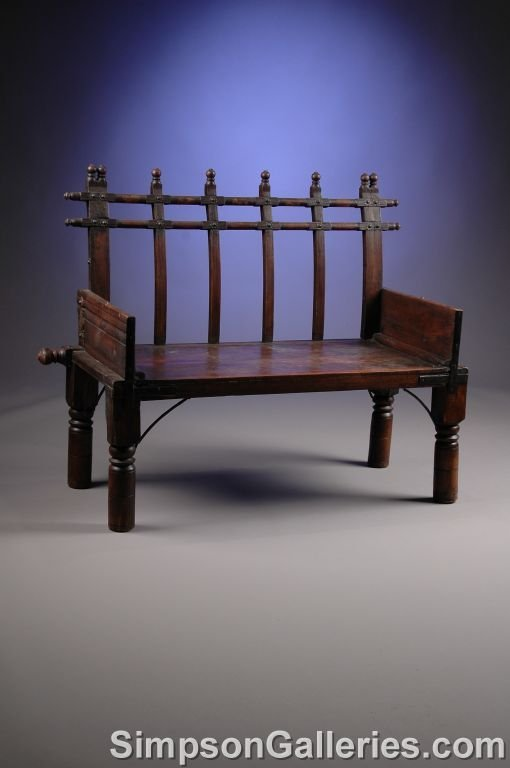 1010: AN ANTIQUE MIDDLE EASTERN CARVED WOOD BENCH,  19t