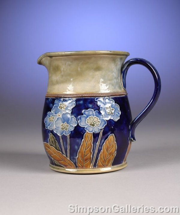 1018: A ROYAL DOULTON LAMBETH GLAZED STONEWARE PITCHER