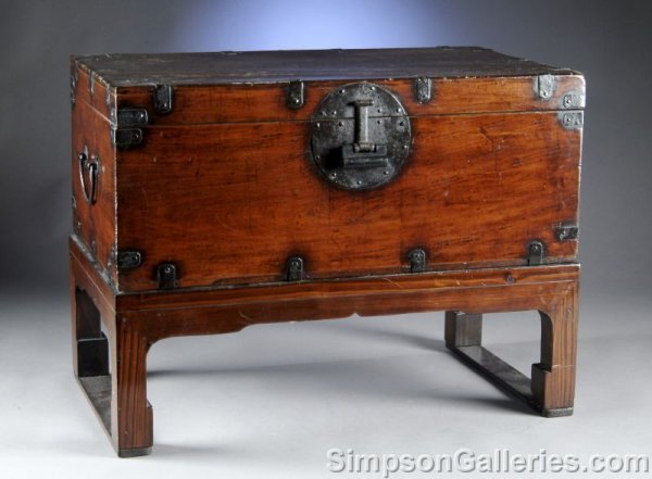 1: A CHINESE STAINED WOOD TRUNK ON LATER STAND, late 19