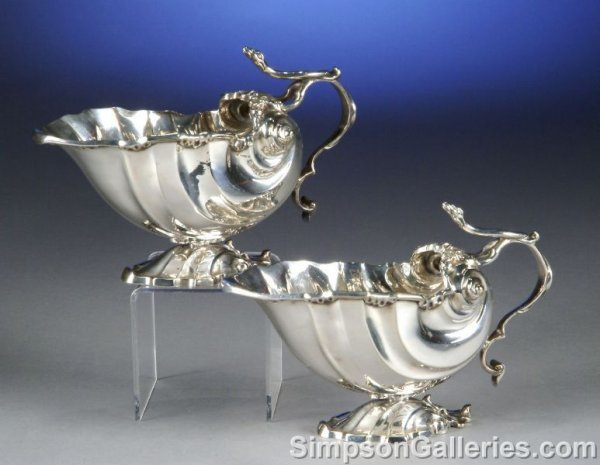 2: A PAIR OF CONTINENTAL SILVER PLATE SHELL FORM SAUCE