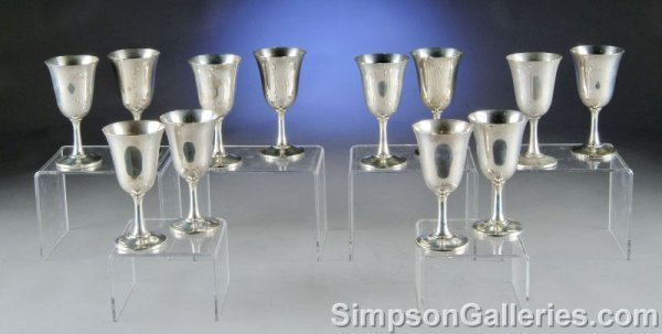 6: A SERVICE OF TWELVE STERLING SILVER WINE GOBLETS by