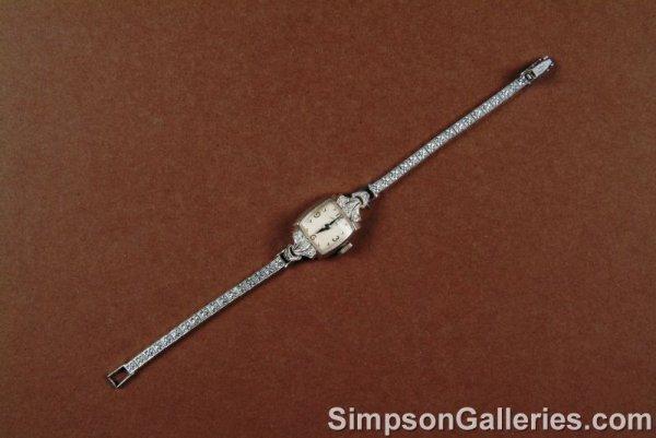 18: A 14K WHITE GOLD AND DIAMOND LADY'S HAMILTON wrist