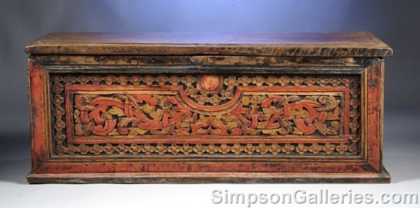 20: A CONTINENTAL CARVED WALNUT CHEST, possibly Scandin