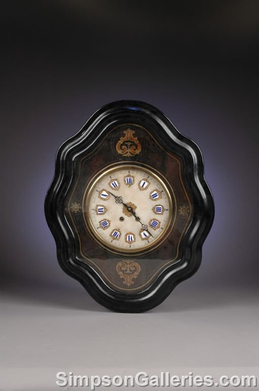 20: A NAPOLEON III BOULLE MARQUETRY AND WALNUT CLOCK, t