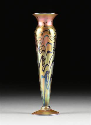 A LUNDBERG STUDIOS IRIDIZED ART GLASS FOOTED VASE,