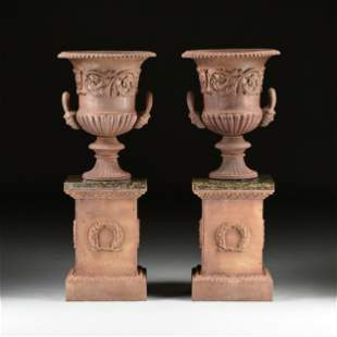 A PAIR OF VICTORIAN CAST IRON URN JARDINIÈRES AND