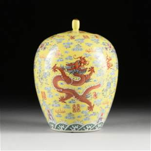 A QING DYNASTY YELLOW GROUND FAMILLE ROSE DRAGON JAR,