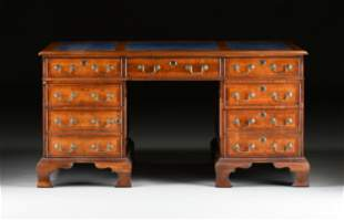 A GEORGE II STYLE WALNUT BLUE LEATHER TOP PARTNER'S