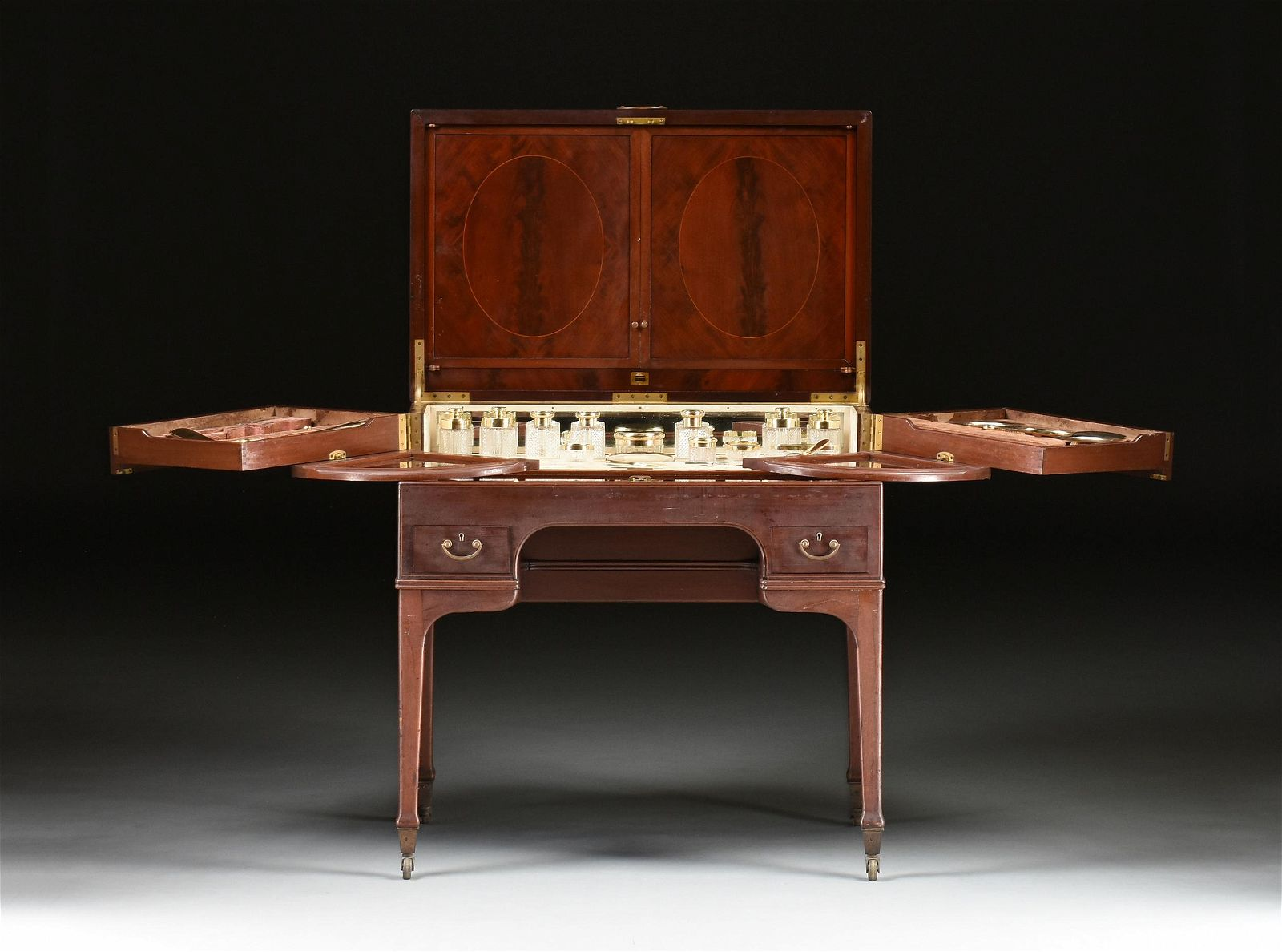 A GEORGE V MAHOGANY DRESSING TABLE AND STERLING SILVER