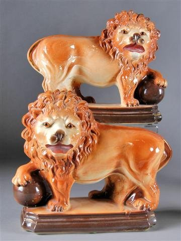 7: A PAIR OF STAFFORDSHIRE GLAZED EARTHENWARE FIGURES O