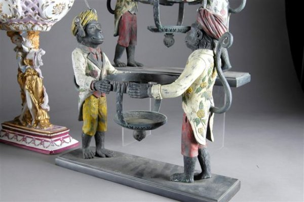 10: A PAIR OF POLYCHROME PAINTED SPELTER JARDINIÈRES, l