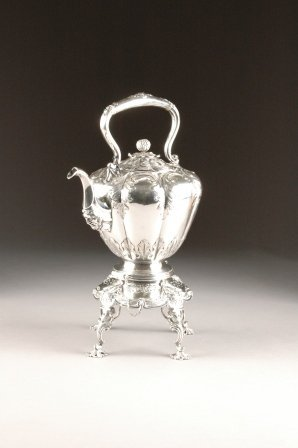 16: A VICTORIAN SILVER PLATED TEAPOT ON STAND, second h