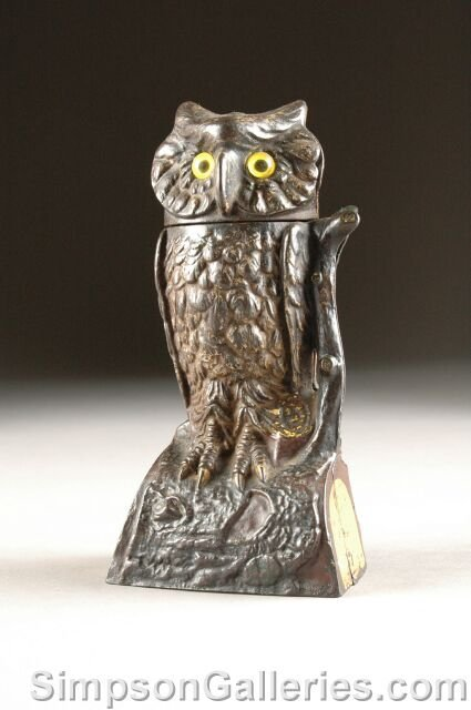 6: AN ANTIQUE AMERICAN CAST-IRON OWL MECHANICAL BANK by
