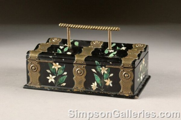 23: A VICTORIAN BRASS MOUNTED BLACK LACQUER AND FLORAL