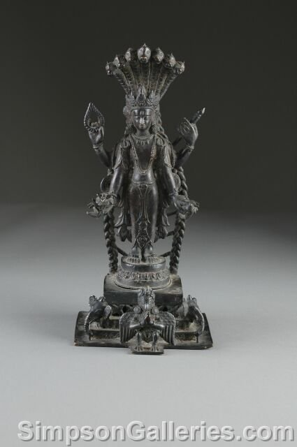 5: AN ANTIQUE INDIAN BRONZE SCULPTURE OF SHIVA, the Hin