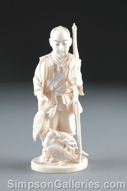 9: A MEIJI PERIOD CARVED IVORY FIGURE OF AN ELDER FISHE