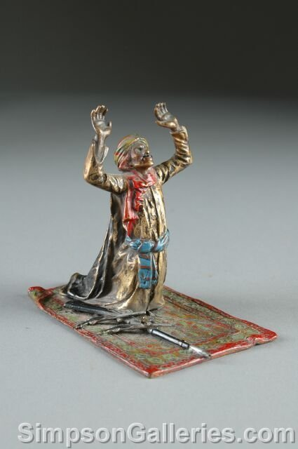 17: AN VIENNESE COLD PAINTED BRONZE FIGURE OF AN ARAB W