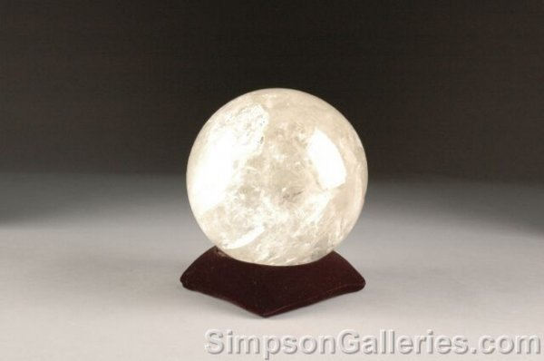 23: A BRAZILIAN ROCK CRYSTAL SPHERE, polished from a na