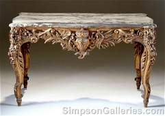 251 A LOUIS XV STYLE CARVED AND GILTWOOD MARBLE TOP TA