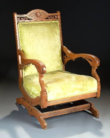 3: A VICTORIAN CARVED OAK AND UPHOLSTERED ROCKING CHAIR