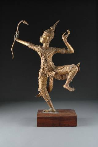 10: A THAI GILT METAL FIGURE OF A DANCING SNAKE CHARMER