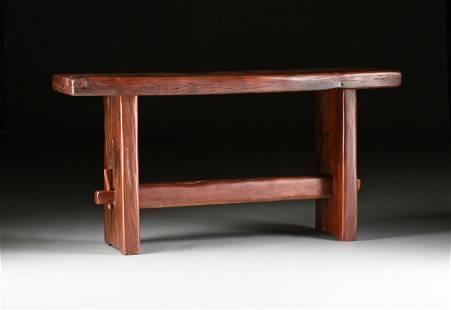 AN AFRICAN RECLAIMED BUBINGA WOOD TRESTLE TABLE, LATE